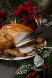 Carving Roasted Christmas Turkey with Grab Apples stock photos