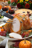 Carving Roasted Turkey on Harvest Table Royalty Free Stock Photography
