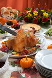 Carving Roasted Turkey on Harvest Table Royalty Free Stock Photos
