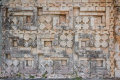 Carving in the ruins of the ancient Mayan city of Uxmal Stock Photo