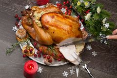 Carving Rustic Style Christmas Turkey Royalty Free Stock Images