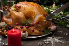 Carving Rustic Style Christmas Turkey Royalty Free Stock Photos