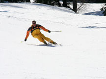 Carving skier. In yellow royalty free stock photos