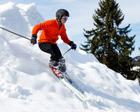 Carving skier. A skier carving through a curve in the winter Stock Photography