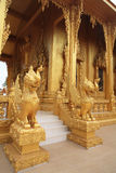 Carving statues on Golden Thai temple Royalty Free Stock Photo