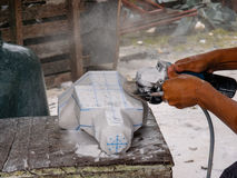 Carving the stone. With the angle grinder Stock Image