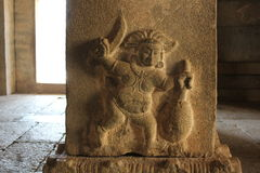 Carving of a strange figure, apparently cutting jackfruit in Vittala temple Royalty Free Stock Images