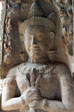 Carving of a temple guardian holding a mace Stock Photo