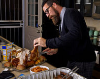 Carving The Thanksgiving Holiday Dinner Turkey Royalty Free Stock Image