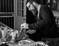 Carving The Thanksgiving Holiday Dinner Turkey. Father carves Thanksgiving holiday dinner turkey stock images