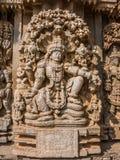 Carving of Vishnu. A carving of the Hindu god Vishnu sitting beneath a tree at the 13th Century temple of Somanathapur, Karnataka, South India Stock Photo