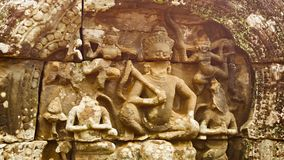 Carving on the wall of ancient temple. Angkor, Cambodia Royalty Free Stock Photography