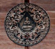 Carving wood of buddha status Stock Photos
