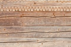 Carving wood, part of the decor. Old wall. Close-up Royalty Free Stock Photography