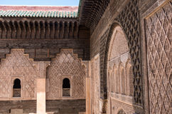 Carving of wood and stone detail. Medersa of Ben Youssef, Marrakech,Morocco stock photos