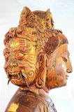 Carving Wooden Bodhisattva Goddess Statue or Guan Yin three face Stock Image