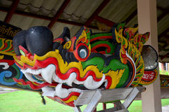 Carving wooden colorful dragon or naga install at head of racing. Boat at Wat Sri Pan Ton is ancient temple for people visit and pray on July 26, 2016 in Nan Royalty Free Stock Photo