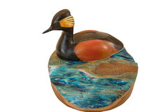 Carving of a wooden duck on a log Stock Photography