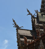 Carving Wooden Roof. Beautiful Thai Carving Wooden Roof on Wooden Building royalty free stock images