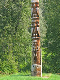 Carvings de pólo de Totem Imagens de Stock