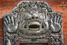 Carvings depicting demons or gods above the entrance to the temp Royalty Free Stock Photos