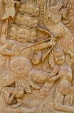 Carvings erklären Geschichten unten auf einem Stück Kleber. Lizenzfreie Stockbilder