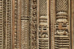 Carvings on the frame of door Stock Image