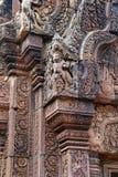 Carvings of garuda the bird man on a corner stone at Banteay Srei temple Royalty Free Stock Photos