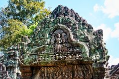 Carvings Historic building in Angkor wat Thom Cambodia. With devatas carvings stone faces serenity milk ocean Stock Photos