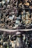 Carvings in Historic building in Angkor wat Thom Cambodia. With devatas carvings stone faces serenity milk ocean Stock Photo