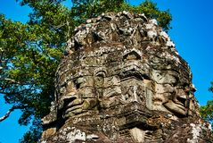 Carvings Historic building in Angkor wat Thom Cambodia. With devatas carvings stone faces serenity milk ocean Royalty Free Stock Photography