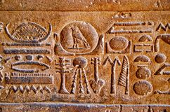 Carvings on the inner wall of Edfu Temple, It is one of the best preserved shrines in Egypt, Dedicated to the falcon god Horus stock photography