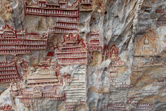 Carvings in Kaw Goon cave background in Myanmar. Carvings in Kaw Goon cave background in Myanmar in Myanmar, back Royalty Free Stock Photos