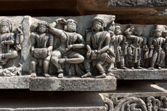 Carvings of musicians. Images of musicians carved on the temple wall at Halebid. Temple wall detail Stock Images