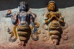 Carvings (Nagas) no monastério de Thiksay Fotografia de Stock
