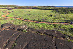 Carvings in the rock in Easter Island. Carvings in the rock and winding path in Easter Island stock photos