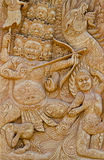 Carvings tell stories down on a piece of cement. Royalty Free Stock Images