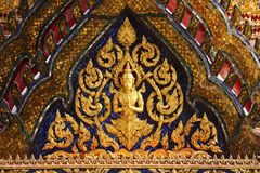 Carvings on the temple roof. Carvings on top tradition roof of the temple, Grand Palace, Bangkok, Thailand Stock Photo