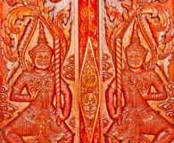 Carvings at Thai temple doors Royalty Free Stock Photo