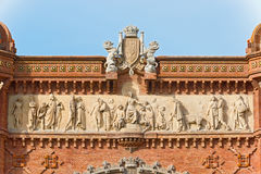 Carvings on the top of The Arch de Triumph in Barcelona, Spain. The Arc de Triumph in Barcelona, Spain was build in 1888 for Universal Exposition. The Arch Royalty Free Stock Photo