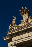 Carvings on top of Colonnades, St Peters Square, with moon. Stock Image