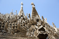 Carvings on top of Shwenandaw Kyaung. Royalty Free Stock Photos
