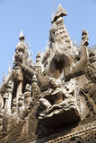 Carvings on top of Shwenandaw Kyaung. Stock Photography