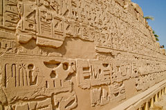 Carvings on walls in ancient Luxor, Egypt. Inscriptions in ancient Luxor, Egypt Stock Images