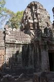 Carvings on the walls and tower of a building in the 12th Century Ta Som temple complex. Scene around the Angkor Archaeological Park. The site contains the Royalty Free Stock Images