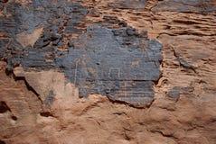 carvingspetroglyphsrock royaltyfri foto