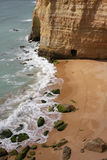 Carvoeiro Beach. Isolated beach in Algarve (south of Portugal) with a cave and footprints Stock Photos