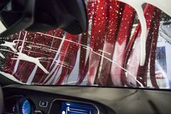Car wash with electric brushes and active foam Royalty Free Stock Photography
