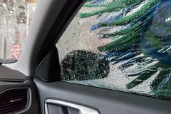 Car wash with electric brushes and active foam Royalty Free Stock Photo