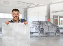 Carwash. Workers presenting empty banner Royalty Free Stock Images